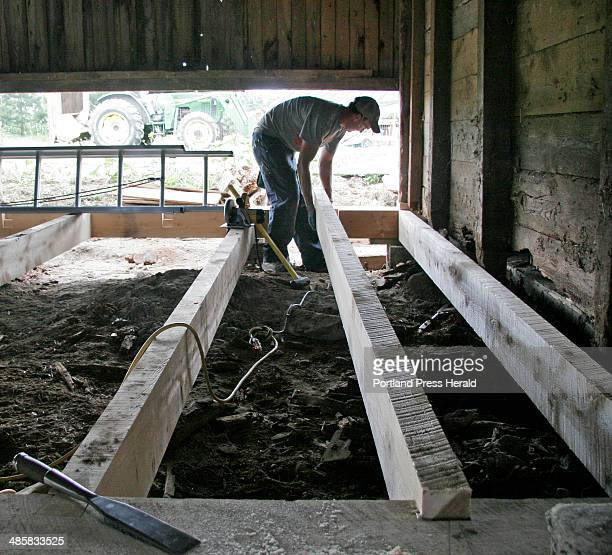 Jon Courtney places a timber in the floor of a barn at Broadturn Farm in Scarborough on Wednesday June 18 2008