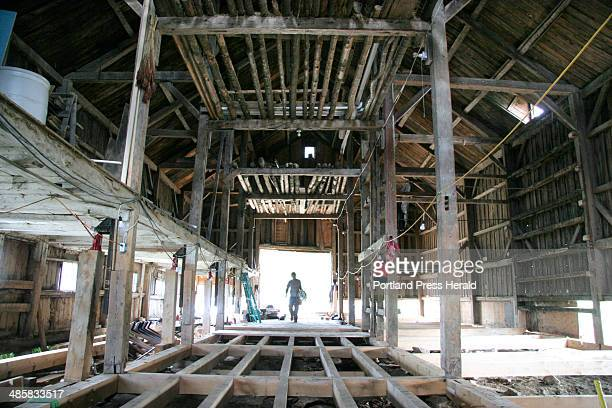 Jon Courtney walks into the dairy barn at Broadturn Farm in Scarborough on Wednesday June 17 2008 The farm is converting the barn and putting into a...