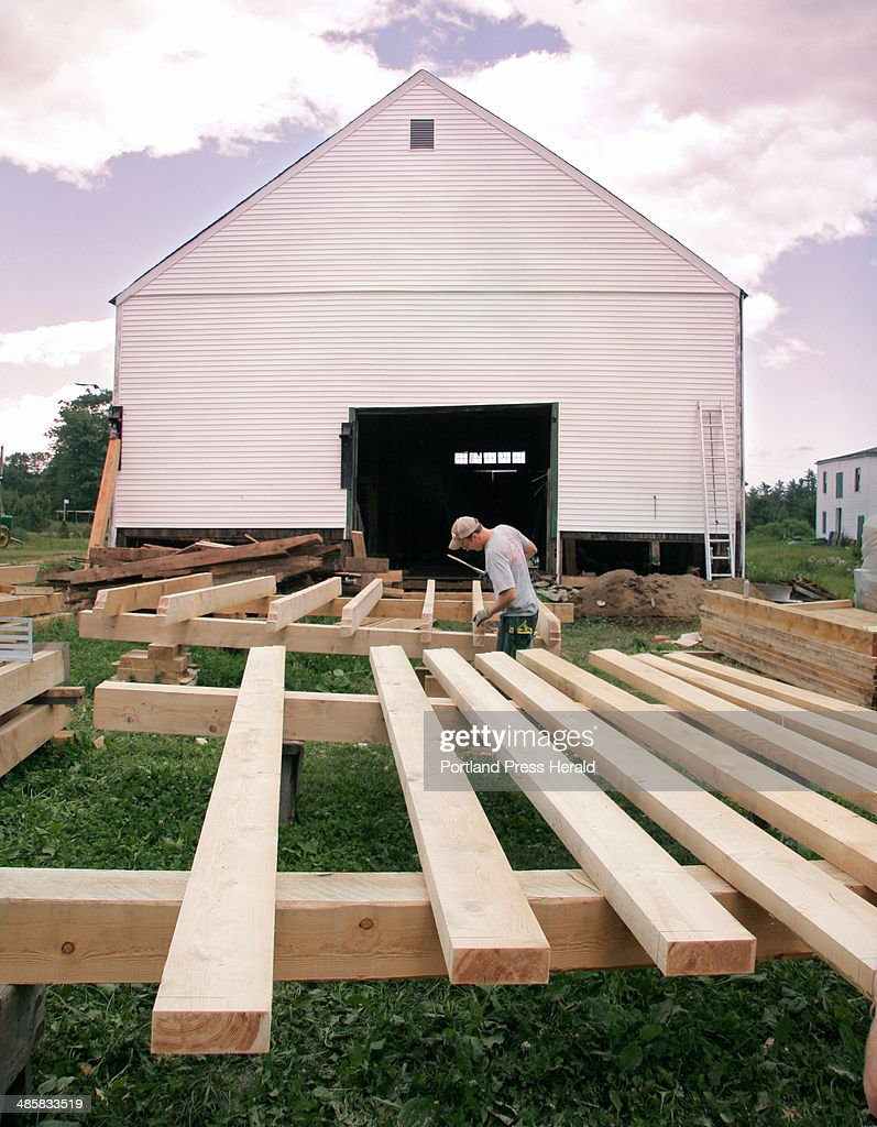 Jon Courtney works with hemlock timbers outside the dairy barn at Broadturn Farm in Scarborough on : News Photo