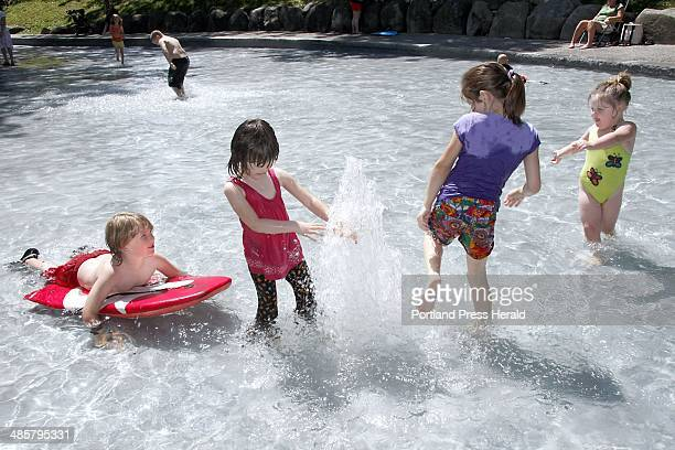 Left to right Eli Evans Alana Turgieva Zalina Turgieva and Rylee Vineyall of Portland play in a popup fountain in the Deering Oaks Ravine which...