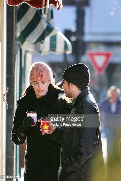 Melissa Cassidy a native of Portland and Phil Marano sip warm drinks while window shopping and visiting town while on vacation from New York City...