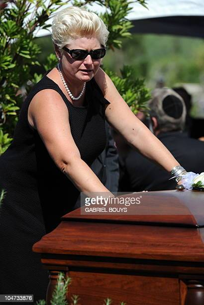 Jill Curtis touches the casket of her husband Hollywood legend Tony Curtis at the Palm Mortuary and Cemetery, Green Valley in Las Vegas on October 4,...