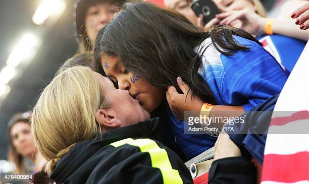 Jill Ellis head coach of the USA kisses a fan in the crowd after the FIFA Women's World Cup Canada 2015 Group D match between Sweden and Nigeria at...