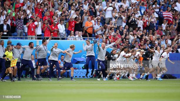 Jill Ellis, Head Coach of USA, backroom staff and substitutes of the USA celebrate victory in the 2019 FIFA Women's World Cup France Final match...