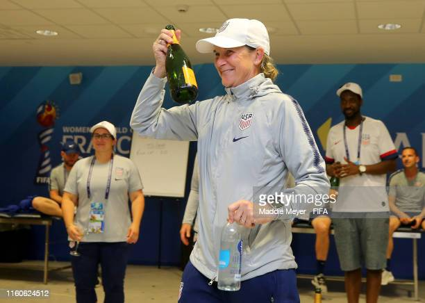 Jill Ellis, Head Coach of USA celebrates in the dressing room following the 2019 FIFA Women's World Cup France Final match between The United States...