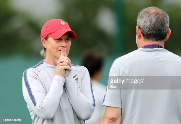 Jill Ellis, Head Coach of USA speaks to a member of a staff during the USA Training Session at Lyon Training Center on July 01, 2019 in Lyon, France.