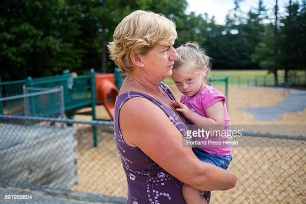 Jill Flagg holds Hannah Allen at Songo Locks School on the second to last day of their special 'Jump Start' program The program has three teachers in...