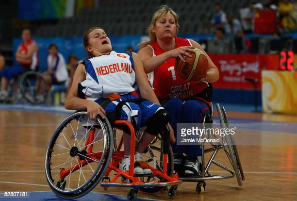 Jill Fox of Great Britain battles with Cher Korver of Holland in the Wheelchair Basketball match between Holland and Great Britain at the National...
