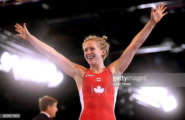 Jill Gallays of Canada celebrates after winning the bronze medal in the Women's FS 53kg Bronze Medal match at the Scottish Exhibition and Conference...