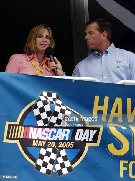 Jill Gregory director of Marketing with Nextel broadcaster Jeff Hammond greet racing fans during a presentation at the NASCAR Day Celebration at the...