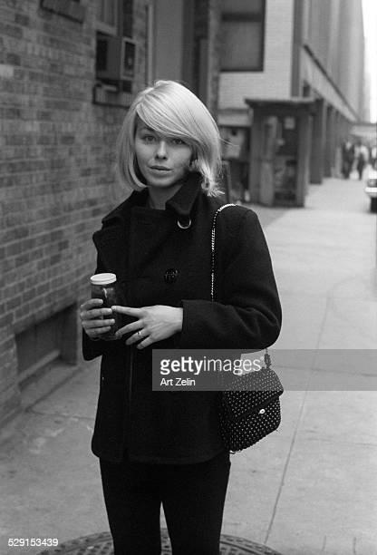 Jill Haworth walking on the street carrying a jar circa 1970 New York