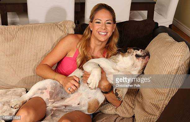 Jill Kussmacher poses with her dog Jolina during an at home photo shoot on July 16 2012 in Los Angeles California