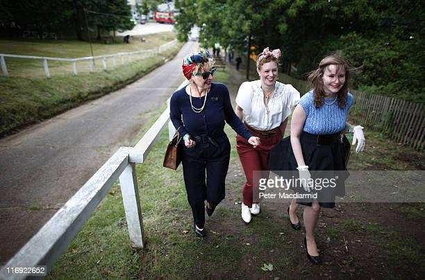 Jill Lovett Katrina Bowles and Rachel Lovett walk up the Test Hill in period costume at The Brooklands Double Twelve Motorsport Festival on June 18...