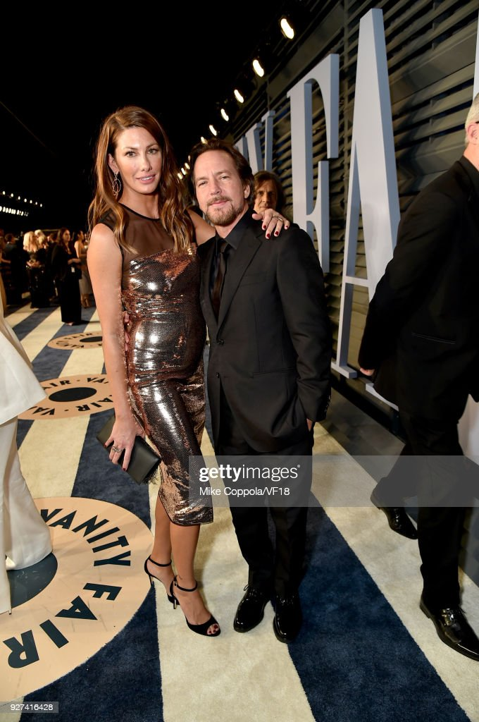 Jill McCormick and Eddie Vedder attend the 2018 Vanity Fair Oscar Party hosted by Radhika Jones at Wallis Annenberg Center for the Performing Arts on March 4, 2018 in Beverly Hills, California.