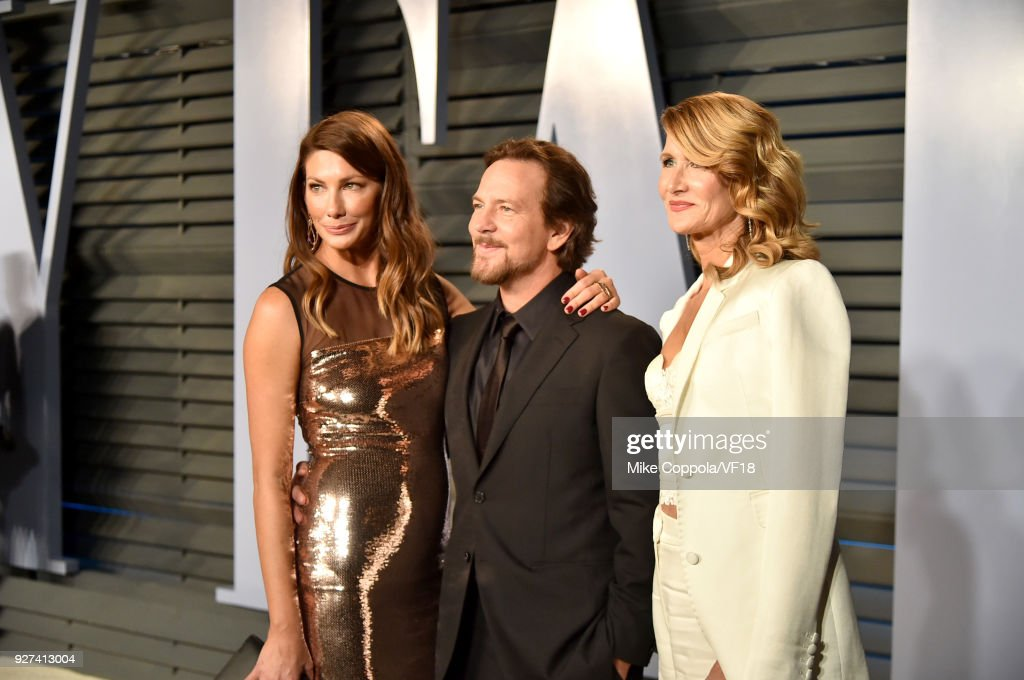 Jill McCormick, Eddie Vedder and Laura Dern attend the 2018 Vanity Fair Oscar Party hosted by Radhika Jones at Wallis Annenberg Center for the Performing Arts on March 4, 2018 in Beverly Hills, California.