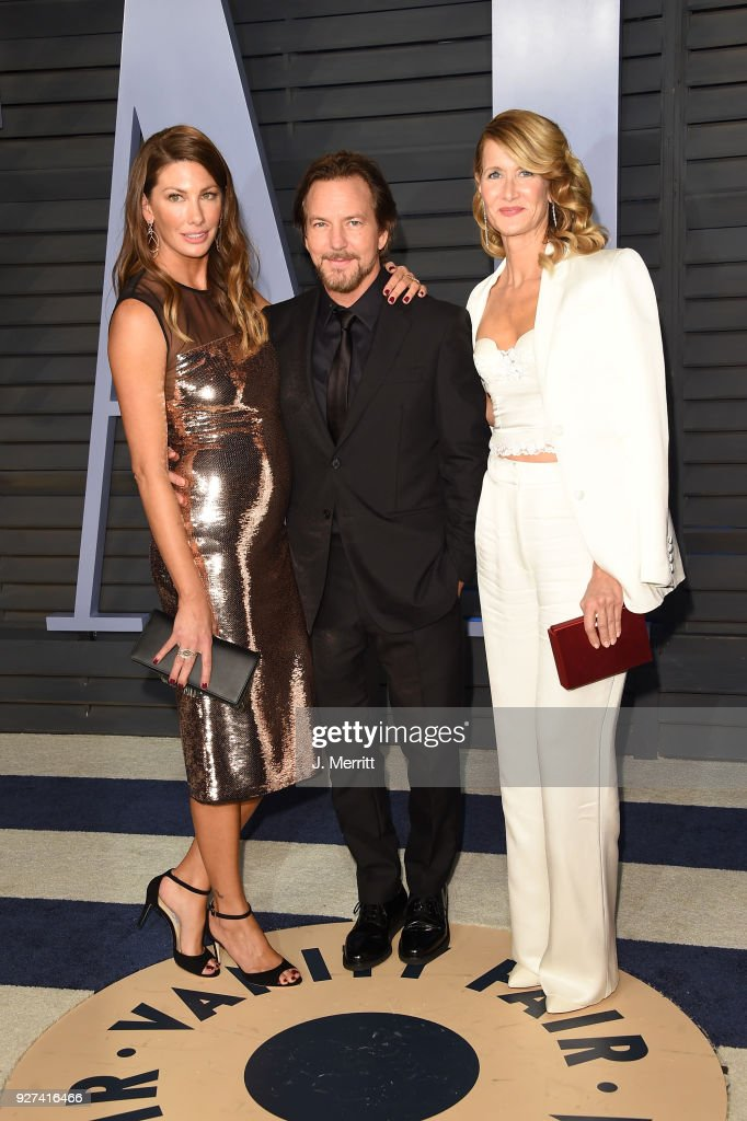 Jill McCormick, Eddie Vedder and Laura Dern attend the 2018 Vanity Fair Oscar Party hosted by Radhika Jones at the Wallis Annenberg Center for the Performing Arts on March 4, 2018 in Beverly Hills, California.