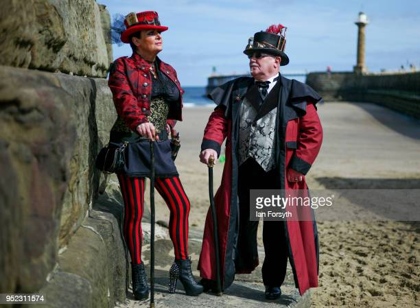 Jill McCreath and David Leonard from Darlington pose against the seawall as they attend Whitby Gothic Weekend on April 28 2018 in Whitby England The...