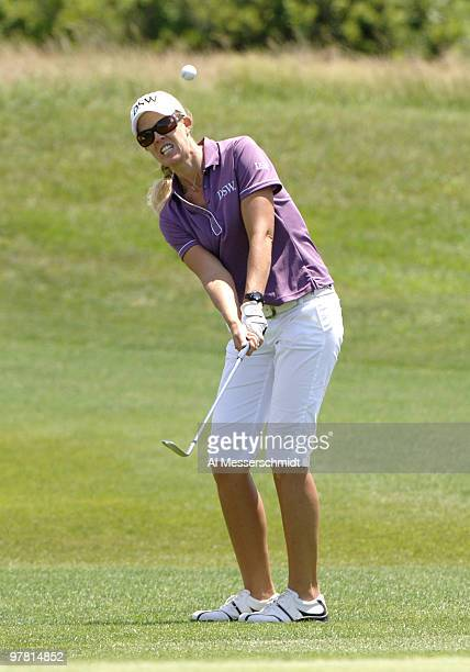 Jill McGill chips into the 13th hole during a practice round at Newport Country Club site of the 2006 U S Women's Open in Newport Rhode Island June...