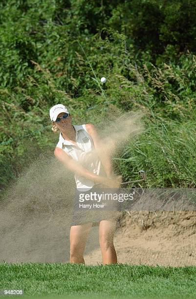 Jill McGill of USA hits from a bunker on the 11th hole during the second round of the US Women's Open on July 5 2002 at Prairie Dunes Country Club in...