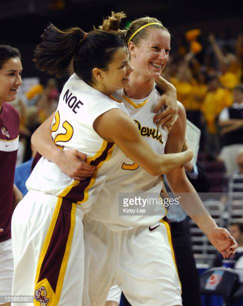 Jill Noe, left, and Aubree Johnson of Arizona State embrace in celebration after 67-58 victory over Louisville in NCAA Women's Basketball...