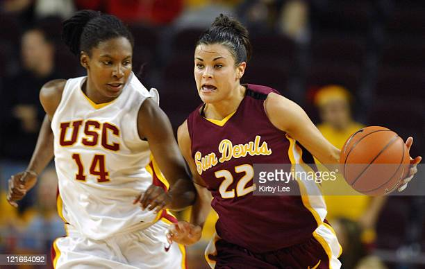 Jill Noe of Arizona State dribbles upcourt defended by Eshaya Murphy of USC during Pacific10 Conference women's basketball game at the Galen Center...