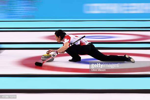 Jill Officer of Canada places a stone during the Gold medal match between Sweden and Canada on day 13 of the Sochi 2014 Winter Olympics at Ice Cube...