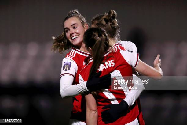 Jill Roord Lisa Evans and Vivianne Miedema of Arsenal celebrate after Vivianne Miedema scored their team's fifth goal during the FA Women's...