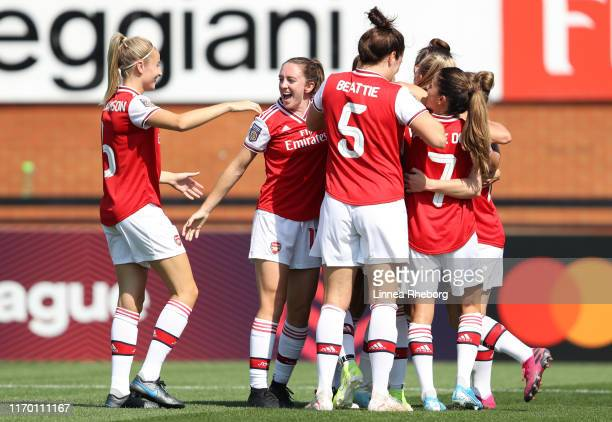 Jill Roord of Arsenal celebrates with team mates after scoring her team's first goal during the pre season friendly match between Arsenal Women and...