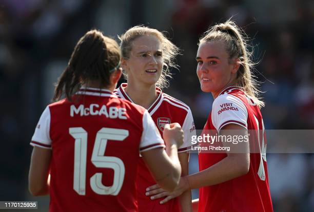 Jill Roord of Arsenal celebrates with team mates Vivianne Miedema and Katie McCabe after scoring their team's fifth goal during the pre season...