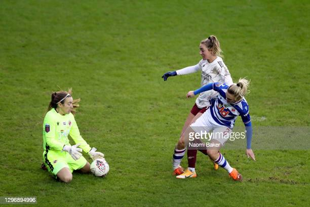 Jill Roord of Arsenal collides with Kristine Leine of Reading as Grace Moloney of Reading saves the ball which leads to Kristine Leine of Reading...
