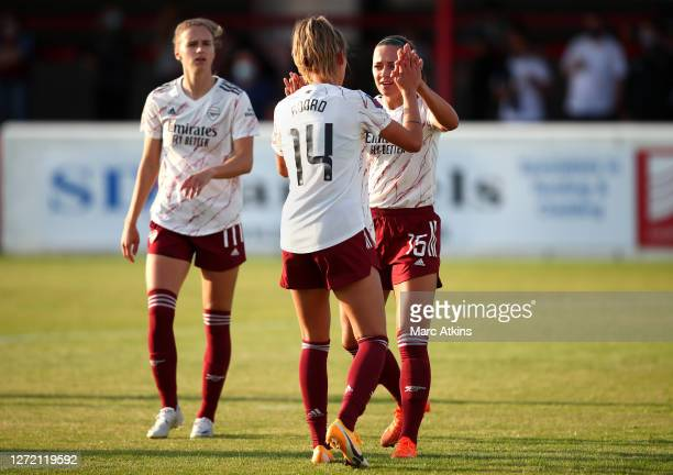 Jill Roord of Arsenal FC celebrates with Katie McCabe after scoring her sides first goal during the FA Women's Super League match between West Ham...