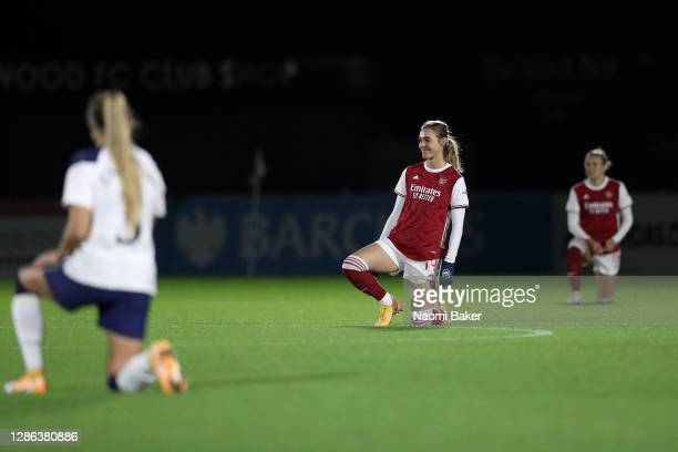 Jill Roord of Arsenal FC takes a knee in support of the Black Lives Matter movement prior to the FA Women's Continental League Cup match between...