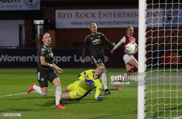 Jill Roord of Arsenal scores her sides first goal with a deflection off Millie Turner of Manchester United during the Barclays FA Women's Super...