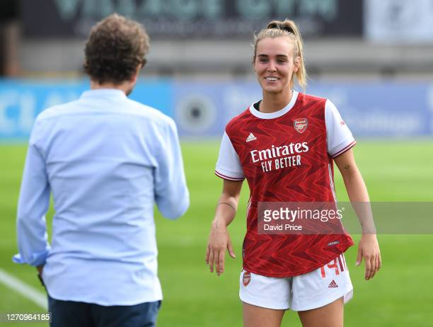 Jill Roord of Arsenal shares a joke with Arsenal Women's Manager Joe Montemurro the match between Arsenal Women and Reading Women at Meadow Park on...