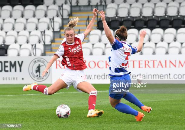 Jill Roord of Arsenal shoots under pressure from Emma Mitchell of Reading during the match between Arsenal Women and Reading Women at Meadow Park on...