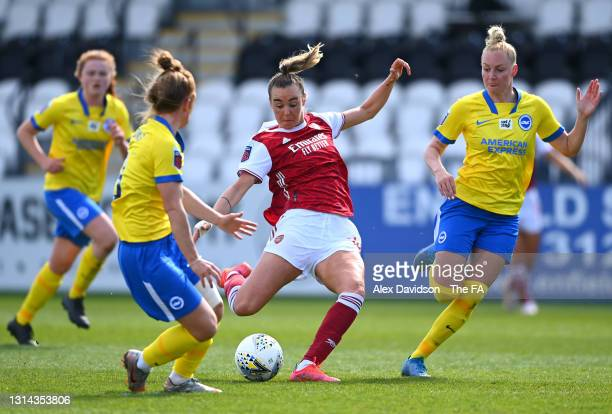 Jill Roord of Arsenal shoots while under pressure from Felicity Gibbons of Brighton and Hove Albion and Danique Kerkdijk of Brighton and Hove Albion...