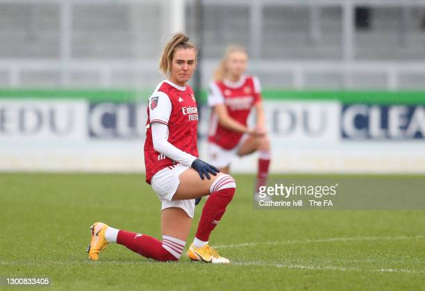 Jill Roord of Arsenal takes a knee in support of the Black Lives Matter movement ahead of the Barclays FA Women's Super League match between Arsenal...