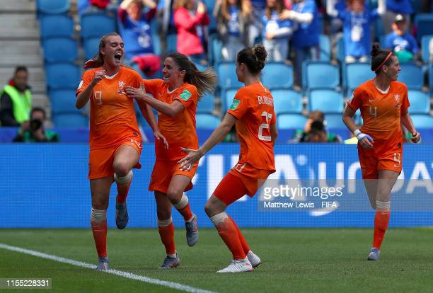 Jill Roord of the Netherlands celebrates with teammates after scoring her team's first goal during the 2019 FIFA Women's World Cup France group E...