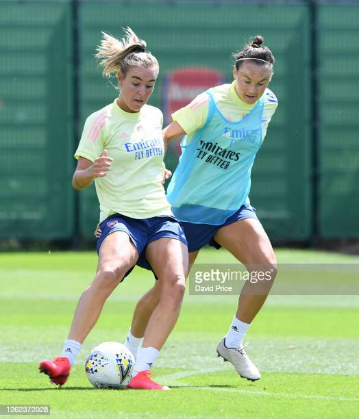 Jill Roord takes on Caitlin Foord of Arsenal during the Arsenal Women training session at Arsenal Academy on July 29 2020 in Walthamstow England