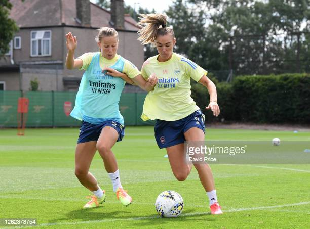 Jill Roord takes on Malin Gut of Arsenal during the Arsenal Women training session at Arsenal Academy on July 29 2020 in Walthamstow England
