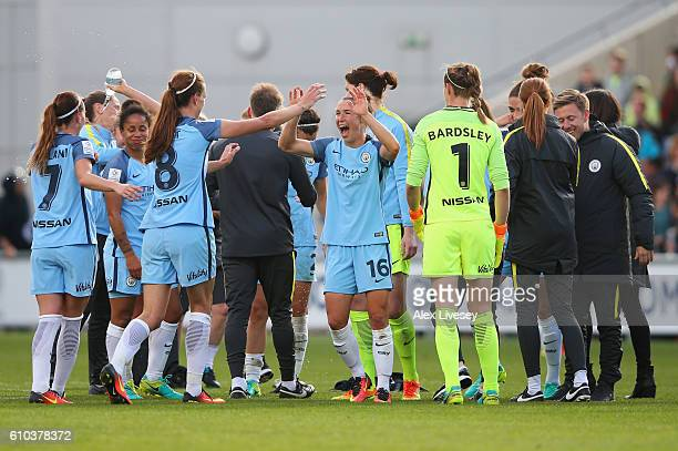 Jill Scott and Jane Ross of Manchester City Women and team mates celebrate as they win the WSL title after the WSL 1 match between Manchester City...