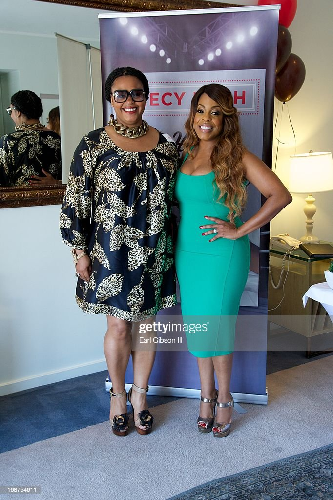 Jill Scott and Niecy Nash pose for a photo as Niecy Nash celebrates the release of her new book 'It's Hard to Fight Naked' at Luxe Rodeo Drive Hotel on May 14, 2013 in Beverly Hills, California.