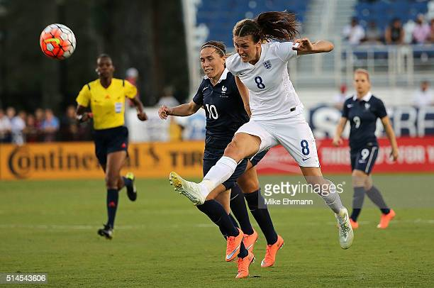 Jill Scott of England and Camille Abily of France fight for the ball during a match against in the 2016 SheBelieves Cup at FAU Stadium on March 9...