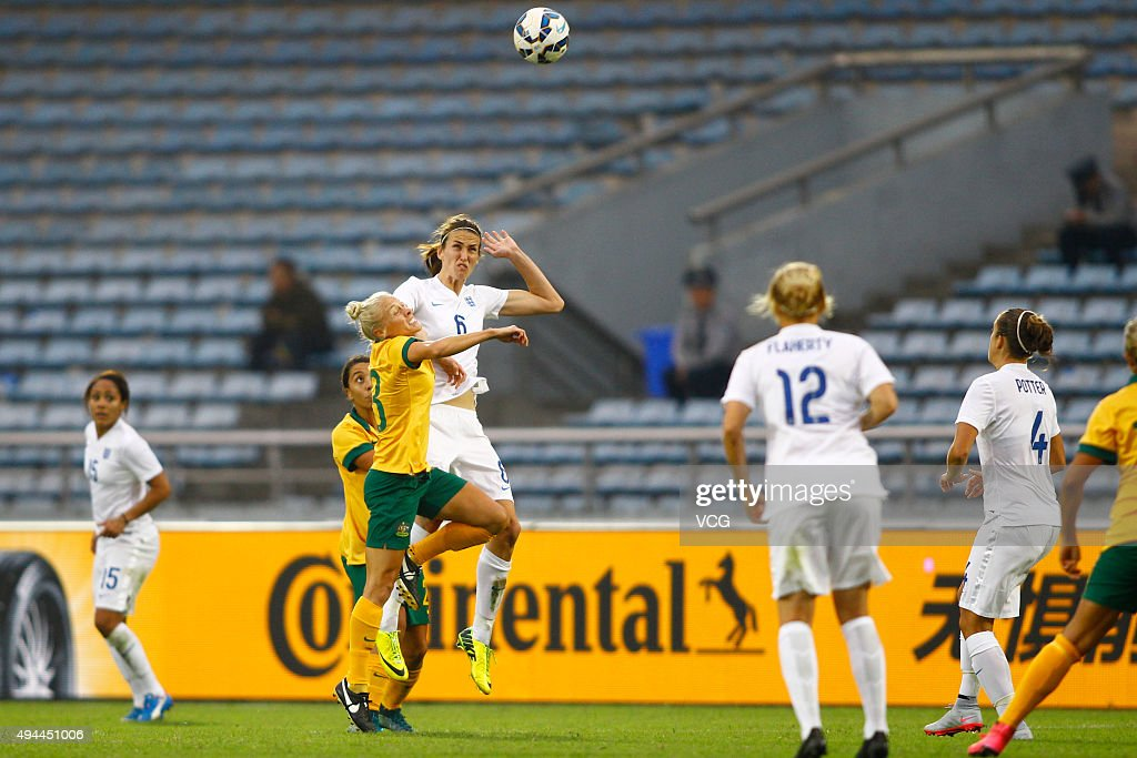Jill Scott #6 of England and Elise Kellond-Knight #8 of Australia compete for the ball in the match between England and Australia during the 2015 Yongchuan Women's Football International Matches at Yongchuan Sports Center on October 27, 2015 in Yongchuan, Chongqing of China.
