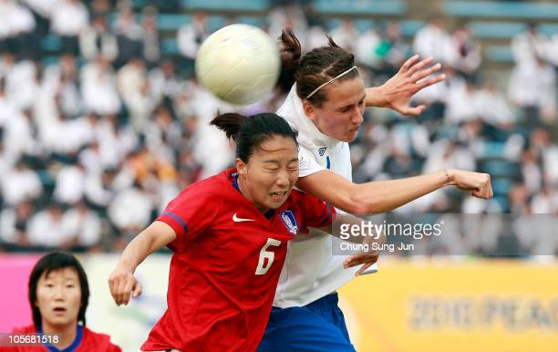 Jill Scott of England and Yu Ji-Eun of South Korea compete for the ball during the Peace Queen Cup match between South Korea and England at Suwon...