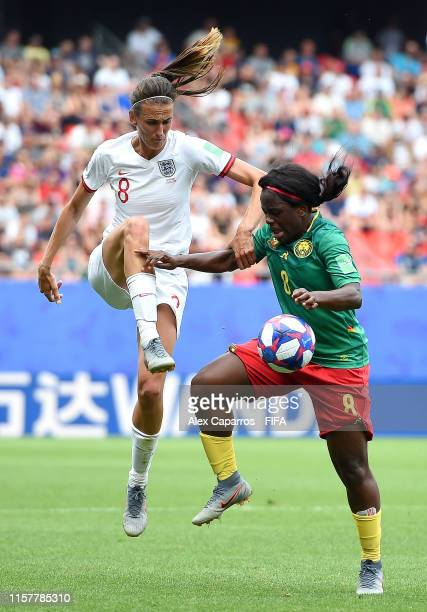 Jill Scott of England battles for possession with Raissa Feudjio of Cameroon during the 2019 FIFA Women's World Cup France Round Of 16 match between...