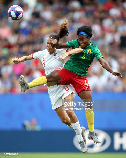 Jill Scott of England battles for possession with Yvonne Leuko of Cameroon during the 2019 FIFA Women's World Cup France Round Of 16 match between...