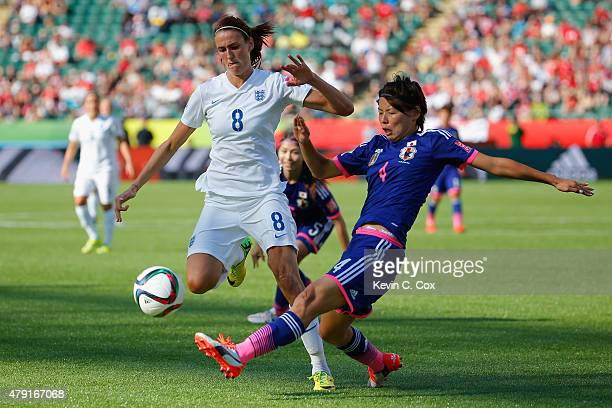 Jill Scott of England battles Saki Kumagai of Japan in action during the FIFA Women's World Cup Semi Final match between Japan and England at the...