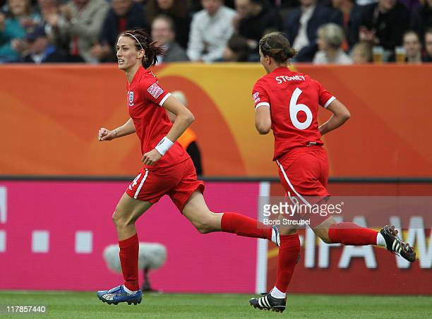 Jill Scott of England celebrates after scoring her team's first goal wth her team mate Casey Stoney during the FIFA Women's World Cup Group B match...