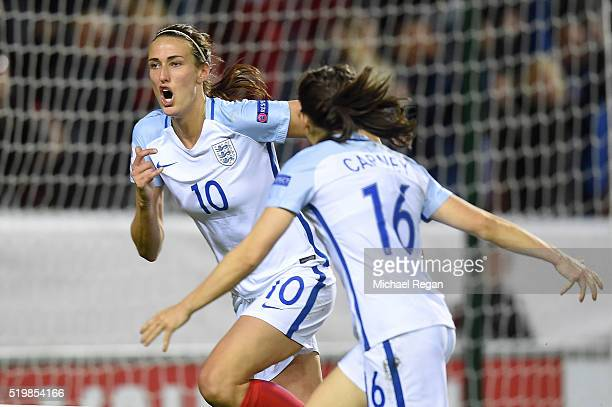 Jill Scott of England celebrates after scoring the equalizing goal during the UEFA Women's European Qualifer between England and Belgium at The New...
